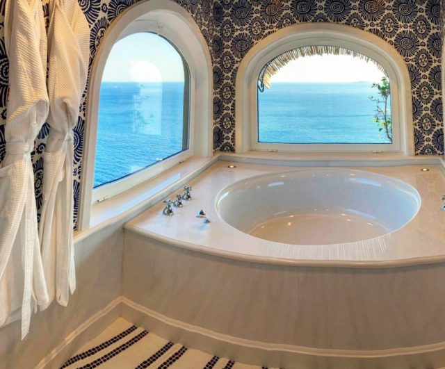 Tub for two? This one was freshly redone this winter, designed by Fausta Gaetani.#ilsanpietrodipositano #relaischateaux #beautifulbathrooms #positano #amalficoast